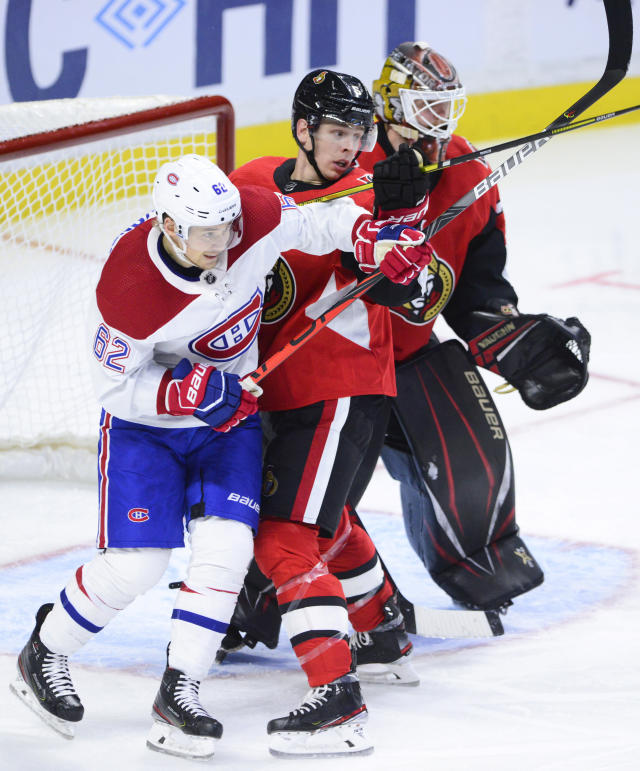 Montreal Canadiens left wing Artturi Lehkonen (62) pushes against Ottawa Senators defenceman Mike Reilly (5) during the second period of an NHL hockey game Saturday, Jan. 11, 2020, in Ottawa, Ontario. (Sean Kilpatrick/The Canadian Press via AP)