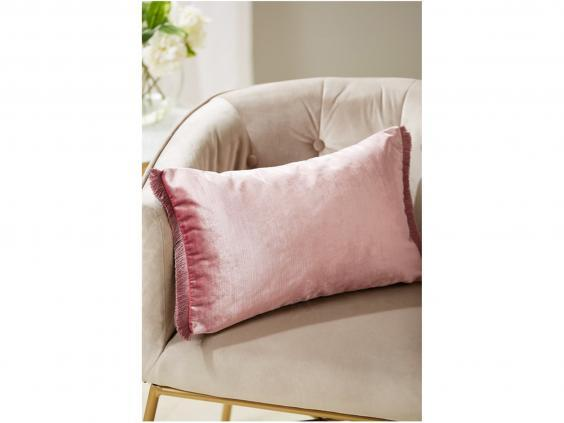 Cushions are an inexpensive way to revamp your home and add colour (Next)