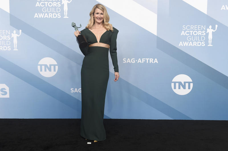 """Laura Dern poses in the press room with the award for outstanding performance by a female actor in a supporting role for """"Marriage Story"""" at the 26th annual Screen Actors Guild Awards at the Shrine Auditorium & Expo Hall on Sunday, Jan. 19, 2020, in Los Angeles. (Photo by Jordan Strauss/Invision/AP)"""