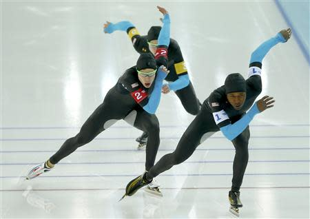 REFILE - CORRECTING BYLINE Shani Davis of the U.S. leads Brian Hansen and Jonathan Kuck of the U.S. in the men's speed skating team pursuit quarter-finals during the 2014 Sochi Winter Olympics, February 21, 2014. REUTERS/Marko Djurica