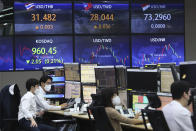 Currency traders watch monitors at the foreign exchange dealing room of the KEB Hana Bank headquarters in Seoul, South Korea, Tuesday, May 18, 2021. Asian shares rose Tuesday, partly on bargain-hunting from the recent global market falls amid continuing pessimism about the coronavirus pandemic. (AP Photo/Ahn Young-joon)