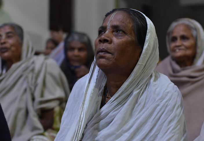 Indian widow women take part in an evening meetings in a widow shelter home, the the old street of Vrindavan, Mathura, India, on March 18, 2019. Life of widows is not so easy in our country India it is very challenging disheartening because they are shunned by their communities and abandoned by their own family. The city which is popular for Lord Krishna childhood story, place which is considered holy by people has become popular for widows Vrindavan is acknowledged as the city of widows. (Photo by Ritesh Shukla/NurPhoto via Getty Images)