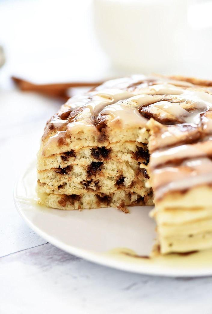 """<p>Give your pancakes the cinnamon bun treatment by topping them with sweet icing. Is it breakfast or dessert? We'll let you decide. </p><p><strong>Get the recipe from <a href=""""https://life-in-the-lofthouse.com/cinnamon-roll-pancakes/"""" rel=""""nofollow noopener"""" target=""""_blank"""" data-ylk=""""slk:Life in the Lofthouse"""" class=""""link rapid-noclick-resp"""">Life in the Lofthouse</a>. </strong></p><p><a class=""""link rapid-noclick-resp"""" href=""""https://go.redirectingat.com?id=74968X1596630&url=https%3A%2F%2Fwww.walmart.com%2Fbrowse%2Fkitchen-tools-gadgets%2Fsilicone-spatula%2F4044_623679_133020_4496646_1374781&sref=https%3A%2F%2Fwww.thepioneerwoman.com%2Ffood-cooking%2Fmeals-menus%2Fg36146701%2Fbest-pancake-toppings%2F"""" rel=""""nofollow noopener"""" target=""""_blank"""" data-ylk=""""slk:SHOP SPATULAS"""">SHOP SPATULAS</a></p>"""