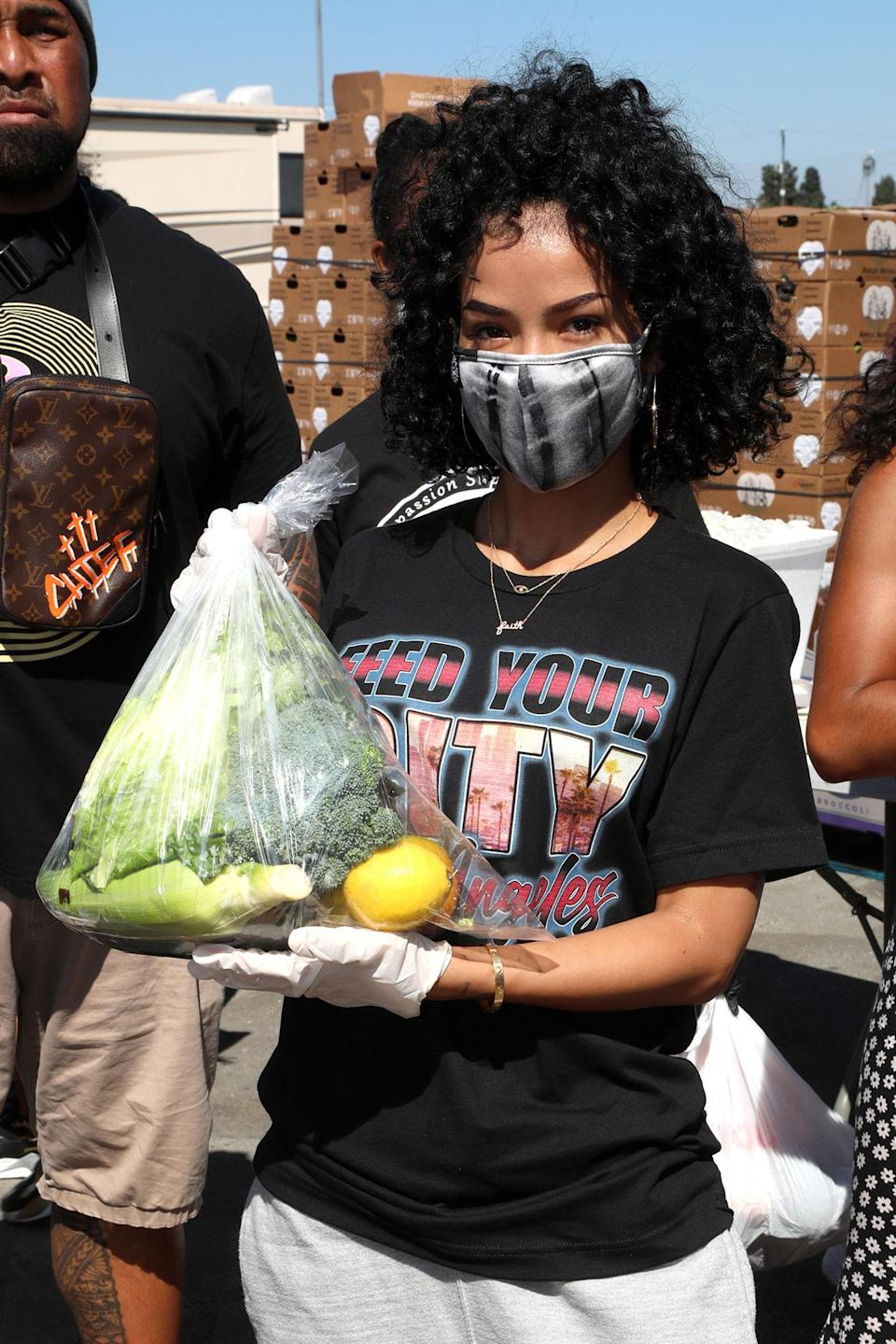 <p>Host Jhené Aiko volunteers at the Feed Your City Challenge Event with co-hosts Mustard and Roddy Ricch (not pictured) in Los Angeles on Saturday.</p>
