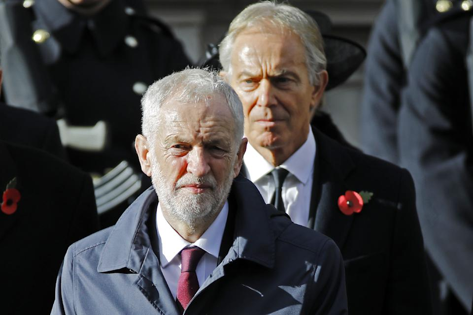 Former Prime Minister Tony Blair (R) stands behind Britain's opposition Labour Party Leader Jeremy Corbyn at the Remembrance Sunday ceremony at the Cenotaph on Whitehall in central London, on November 11, 2018. - On the 100th anniversary of the World War I armistice, the day's events mark the final First World War Centenary commemoration events hosted by the UK Government. Services are held annually across Commonwealth countries during Remembrance Day to commemorate servicemen and women who have fallen in the line of duty since WWI. (Photo by Tolga AKMEN / AFP)        (Photo credit should read TOLGA AKMEN/AFP via Getty Images)