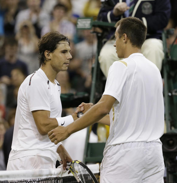 Lukas Rosol, right, of the Czech Republic is congratulated by Rafael Nadal of Spain after Rosol defeated Nadal in a second round men's singles match at the All England Lawn Tennis Championships at Wimbledon, England, Thursday, June 28, 2012. (AP Photo/Anja Niedringhaus)