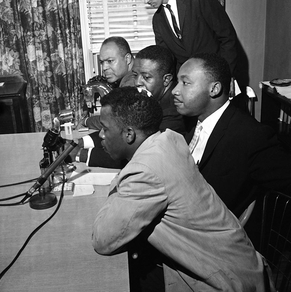 Civil rights leaders hold a news conference in Montgomery, Ala., and announce that the Freedom Rides will continue, May 23, 1961. In the foreground is John Lewis, one of the riders who was beaten. Others, left to right: James Farmer, Rev. Ralph Abernathy and Rev. Martin Luther King. Lewis wears bandage on head. (Photo: AP)