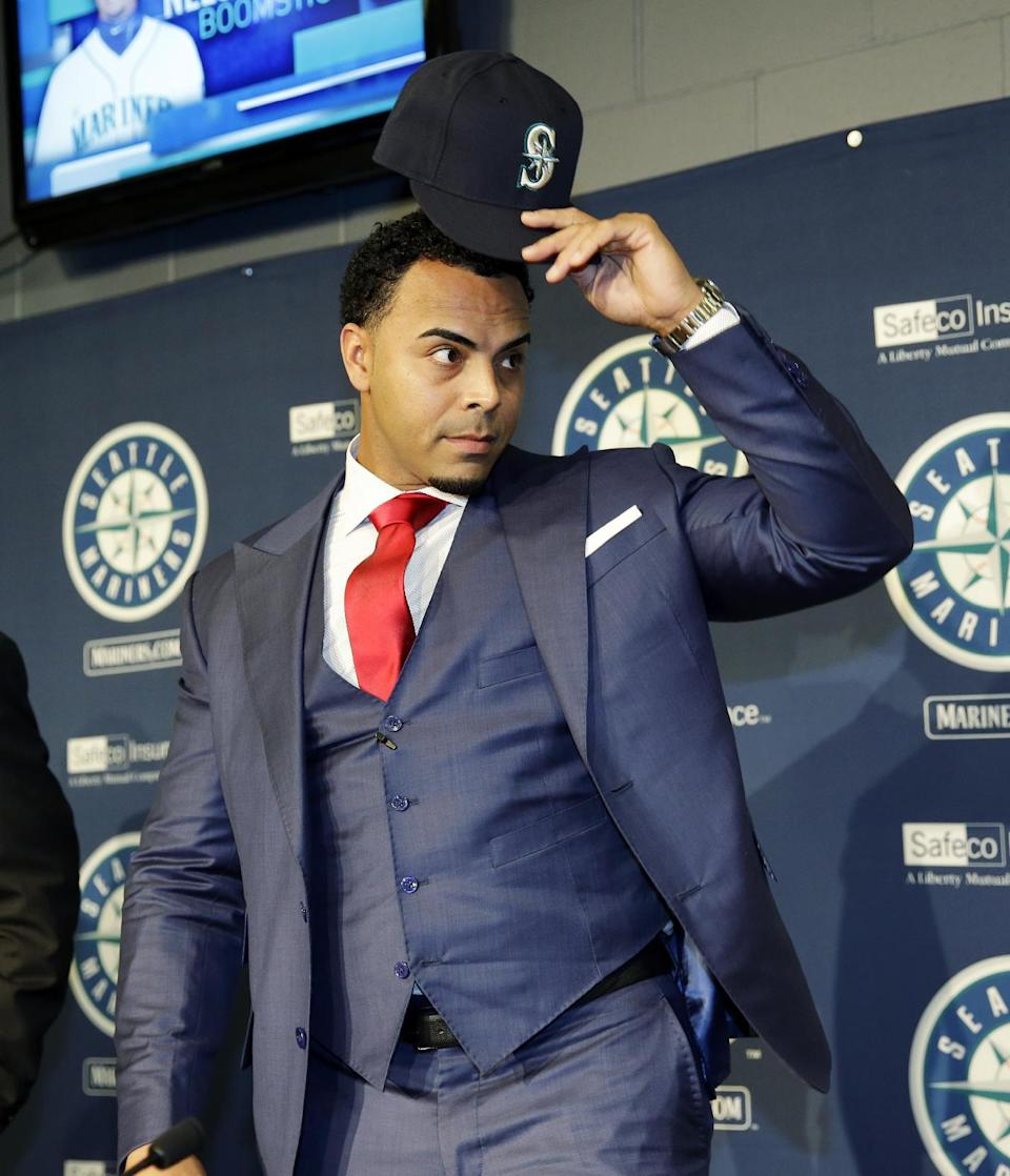 Seattle Mariners' Nelson Cruz removes his baseball cap after wearing it for photographers after he was introduced at a baseball news conference, Thursday, Dec. 4, 2014, in Seattle. (AP Photo/Ted S. Warren)