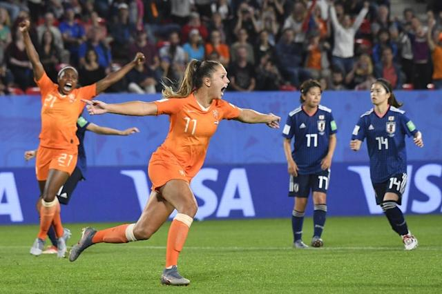 Lieke Martens celebrates after sending the goalkeeper the wrong way to score the Netherlands' last-minute penalty winner against Japan (AFP Photo/Damien MEYER)