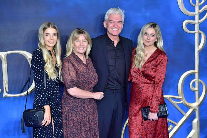 """Phillip Schofield, Stephanie Lowe, Ruby Lowe (L) and Molly Lowe (R) attend the UK Premiere of """"Fantastic Beasts: The Crimes Of Grindelwald"""" at Cineworld Leicester Square on November 13, 2018 in London, England. (Photo by Samir Hussein/Samir Hussein/WireImage)"""