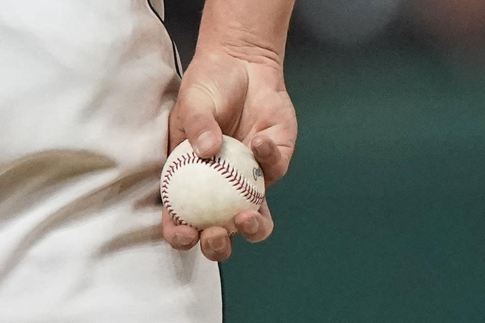 Cleveland Indians relief pitcher James Karinchak holds the ball between pitches during the eighth inning of the team's baseball game against the Baltimore Orioles, Tuesday, June 15, 2021, in Cleveland. (AP Photo/Tony Dejak)