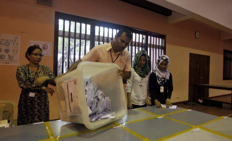 An election official empties out a ballot box to count votes after polling for presidential elections closed in Male, Maldives, Saturday, Nov. 9, 2013. After two months of political bickering and repeated failure to hold a presidential election, people in the Maldives voted Saturday to elect a new leader for their budding but vulnerable democracy. (AP Photo/Sinan Hussain)