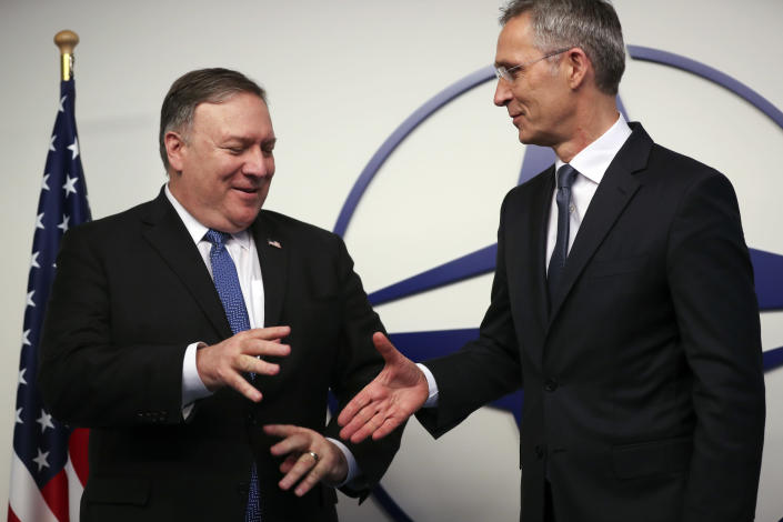 U.S. Secretary of State Mike Pompeo, left, shakes hands with NATO Secretary General Jens Stoltenberg prior to a meeting at NATO headquarters in Brussels, Tuesday, Dec. 4, 2018. U.S. Secretary of State Mike Pompeo on Tuesday took aim at China, Iran, Russia and others for violating numerous treaties and multi-state agreements and questioned whether many pillars of international trade and diplomacy are still relevant. (AP Photo/Francisco Seco, Pool)