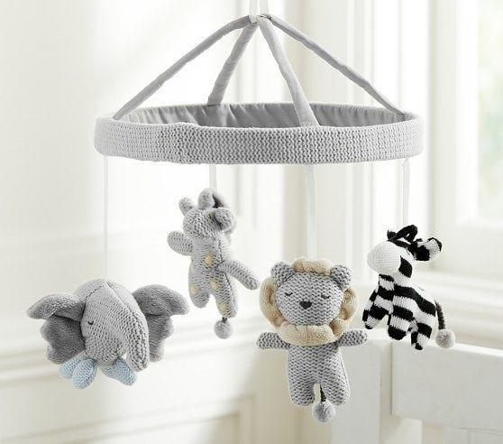 """Your little one will love watching adorable plush animals circle above their crib. This mobile also plays a soothing tune to help them fall asleep.<br /><br />Note: This mobile doesn't come with a mobile arm, but you can buy one from Pottery Barn Kids for <a href=""""https://go.skimresources.com?id=38395X987171&xs=1&xcust=HPThingsNewParentsProbablyWantToBuy-609c0cd1e4b014bd0ca6f04f&url=https%3A%2F%2Fwww.potterybarnkids.com%2Fproducts%2Fmobile-arm%2F"""" target=""""_blank"""" rel=""""noopener noreferrer"""">$29</a>.<br /><strong><br /><a href=""""https://go.skimresources.com?id=38395X987171&xs=1&xcust=HPThingsNewParentsProbablyWantToBuy-609c0cd1e4b014bd0ca6f04f&url=https%3A%2F%2Fwww.potterybarnkids.com%2Fproducts%2Fknit-animal-crib-mobile%2F%3F"""" target=""""_blank"""" rel=""""noopener noreferrer"""">Get it from Pottery Barn Kids for $69.</a><br /></strong>"""