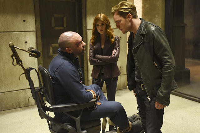 "<p><strong>This Season's Theme:</strong> ""It's the ongoing exploration of identity with all of our characters,"" says executive producer Darren Swimmer.<br><br><strong>Where We Left Off:</strong> Valentine (Alan van Sprang) dropped the bombshell that Jace (Dominic Sherwood) isn't Clary's (Katherine McNamara) brother after all. Simon (Alberto Rosende) walked in the sun, Magnus and Alec (Harry Shum Jr., Matthew Daddario) said the ""L"" word, and an unknown figure made off with the Soul Sword.<br><br><strong>Coming Up:</strong> ""We pick up right in the aftermath of that,"" says Swimmer. ""There's a lot of tumult in the Downworld."" With Simon able to walk outside, it allows him to ""theoretically have a normal life again,"" although Swimmer warns he'll ""soon find out being a vampire isn't something you can usually let go of."" And just because Valentine's in custody, ""it doesn't stop him from creating mischief and mayhem,"" the EP adds. As for that mysterious person who had the Soul Sword in the final 2A scene, Swimmer tells us, ""Those questions are addressed early on in the season.""<br><br><strong>New Kid in Town:</strong> Will Tudor makes his debut as new Shadowhunter Sebastian Verlac in the 2B premiere. ""The character has a lot of sides to him,"" Swimmer says. ""His place evolves as we get deeper into the season in a really juicy way."" The EP also teased the arrival of the Seelie Queen, and confirmed that there's ""a lot of relationship action"" coming up. <em>— Victoria Leigh Miller</em><br><br>(Photo: John Medland/Freeform) </p>"
