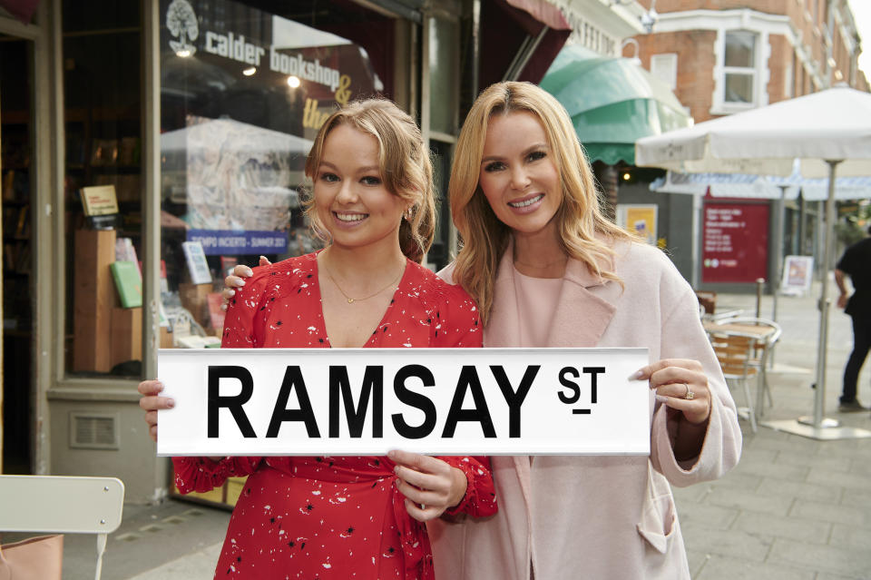 Actress Jemma Donovan and Amanda Holden on set filming for Neighbours (Channel 5).