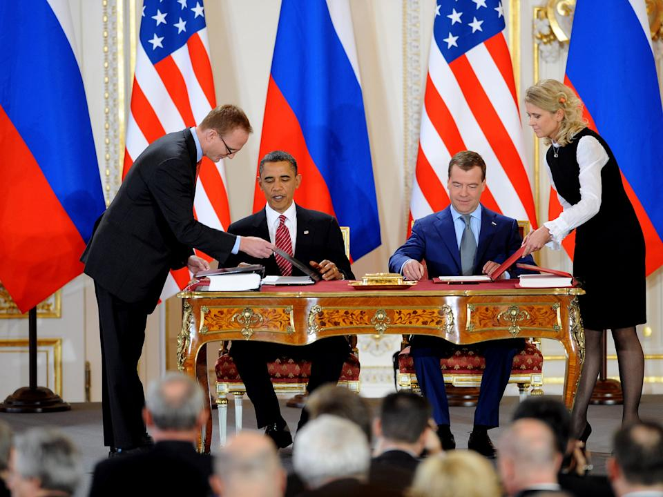 US President Barack Obama (L) and Russian President Dmitry Medvedev sign the new Strategic Arms Reduction Treaty (START) in Prague on April 8, 2010 (AFP via Getty Images)