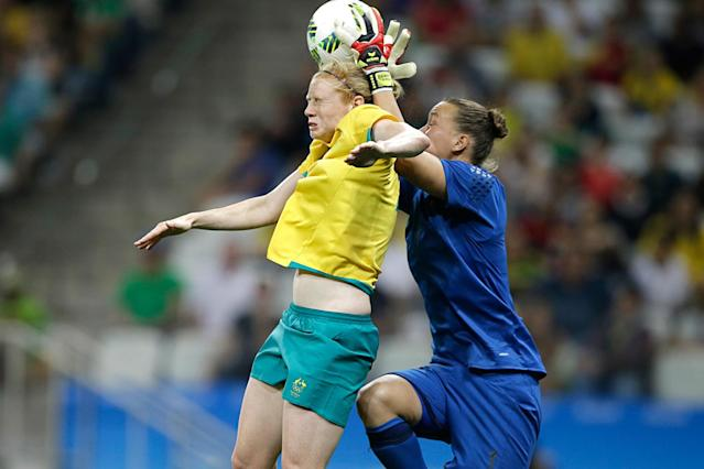 <p>Germany goalkeeper Almuth Schult grabs the ball against Australia's Clare Polkinghorne during a group F match of the women's Olympic football tournament between Germany and Australia in Sao Paulo, Brazil, Saturday, Aug. 6, 2016. (AP Photo/Nelson Antoine) </p>
