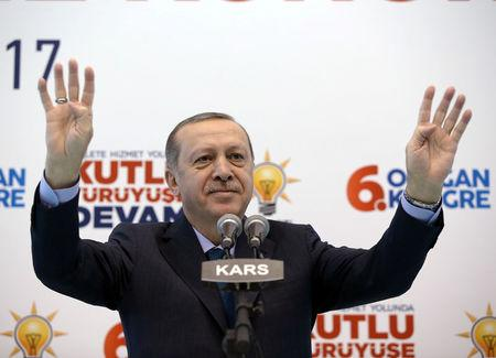 Turkish President Erdogan greets his supporters during a meeting of his ruling AK Party in Kars
