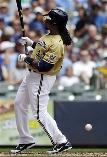 Milwaukee Brewers' Rickie Weeks is hit by a pitch during the second inning of a baseball game against the New York Mets on Sunday, July 7, 2013, in Milwaukee. (AP Photo/Morry Gash)