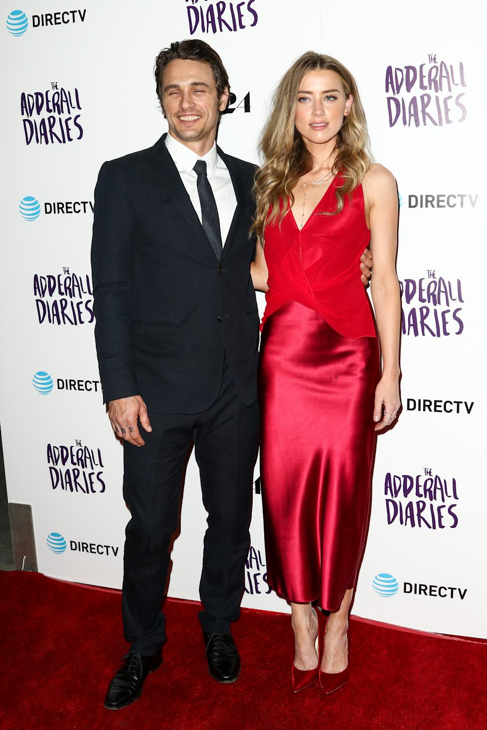 """James Franco, left, and Amber Heard attend the LA Premiere of """"The Adderall Diaries"""" held at ArcLight Hollywood on Tuesday, April 12, 2016, in Los Angeles. (Photo by John Salangsang/Invision/AP)"""