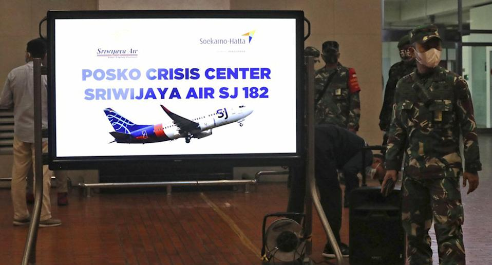 Soldiers stand near a crisis centre set up following a report that a Sriwijaya Air passenger jet has lost contact with air traffic controllers after take off, at Soekarno-Hatta International Airport in Indonesia