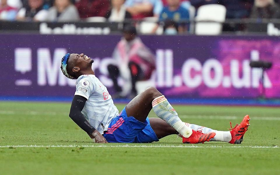 Manchester United's Paul Pogba appears injured during the Premier League match at the London Stadium - PA