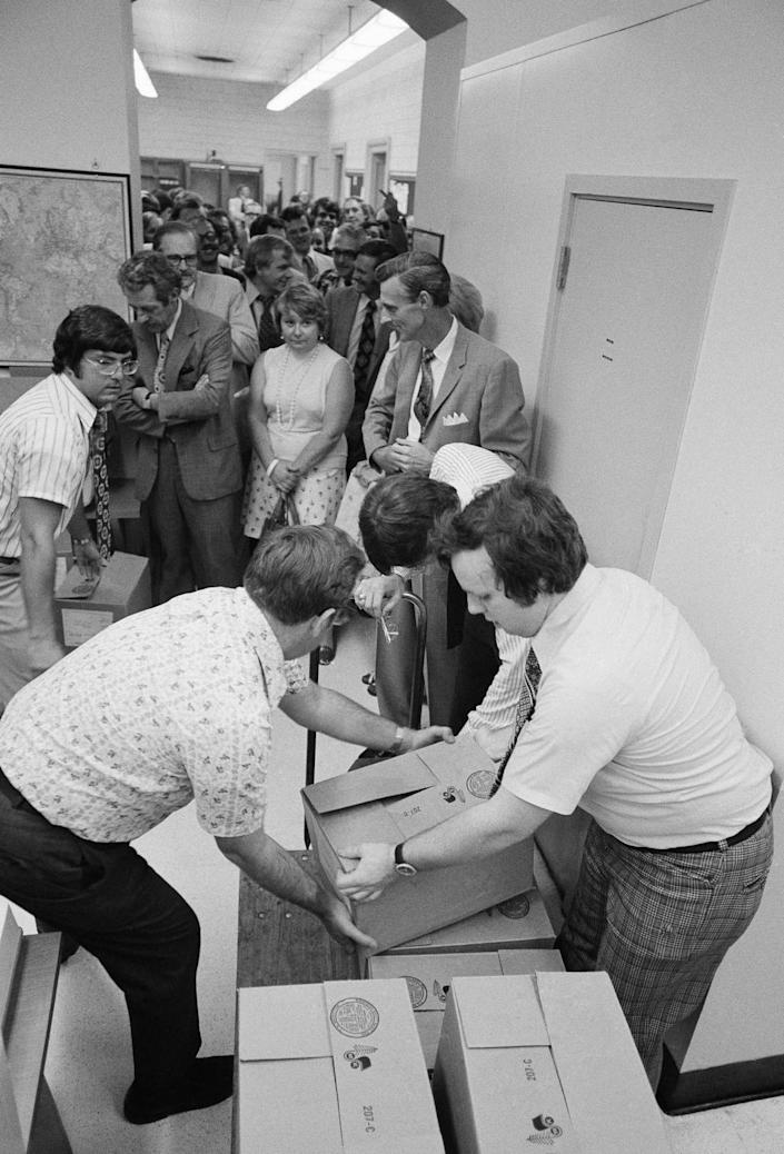 <p>Reporters line up to receive copies of the eight volumes of evidence distributed to the press by the House Judiciary Committee, July 10, 1974, on Capitol Hill. (Photo: Henry Burroughs/AP) </p>