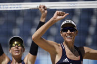 Alix Klineman, right, of the United States, and teammate April Ross celebrate winning a women's beach volleyball semifinal match against Switzerland at the 2020 Summer Olympics, Thursday, Aug. 5, 2021, in Tokyo, Japan. (AP Photo/Felipe Dana)