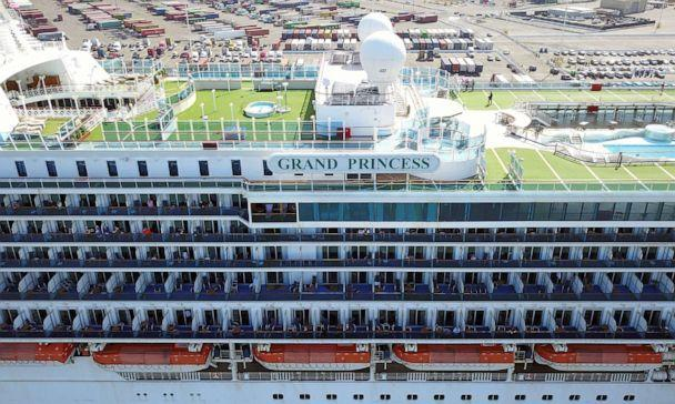 PHOTO: Passengers look out as the Grand Princess cruise ship docks at the Port of Oakland in Oakland, California, on March 9, 2020. (Josh Edelson/AFP via Getty Images)