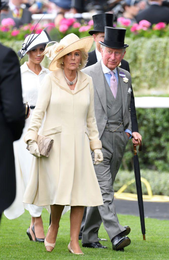 """<p>Camilla Parker Bowles chose a pleated cream-colored dress and matching floral hat to the opening day of <a href=""""https://www.townandcountrymag.com/society/tradition/g21613757/royal-ascot-2018-opening-day-photos/"""" rel=""""nofollow noopener"""" target=""""_blank"""" data-ylk=""""slk:Royal Ascot"""" class=""""link rapid-noclick-resp"""">Royal Ascot</a>.</p>"""