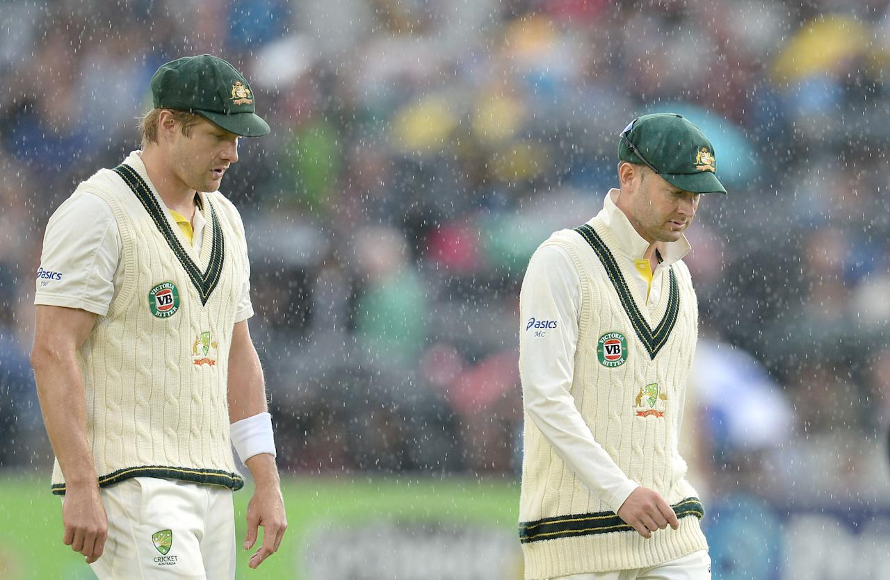 Australia's Michael Clarke leaves the pitch as rain stops play, during day five of the Third Investec Ashes test match at Old Trafford Cricket Ground, Manchester.