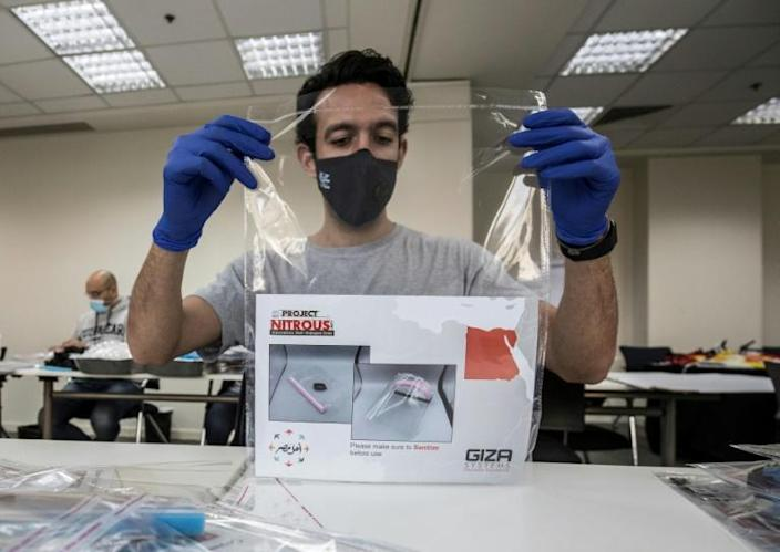 The face shield can be 3-D printed in plastic, cut out by laser and simply assembled (AFP Photo/Khaled DESOUKI)