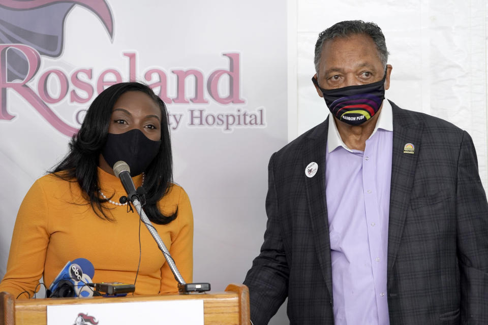 FILE - In this Jan. 8, 2021, file photo, Kizzmekia Corbett, left, an immunologist with the Vaccine Research Center at the National Institute of Health, and the Rev. Jesse Jackson, respond to questions after Jackson received his first COVID-19 vaccine at the Roseland Community Hospital in Chicago. Corbett, a Black U.S. government scientist who helped develop Moderna's vaccine, acknowledges ''centuries of medical injustice'' against Black Americans but said COVID-19 vaccines resulted from years of solid research. Trust in those vaccines, she said, is needed to save lives. (AP Photo/Charles Rex Arbogast, File)