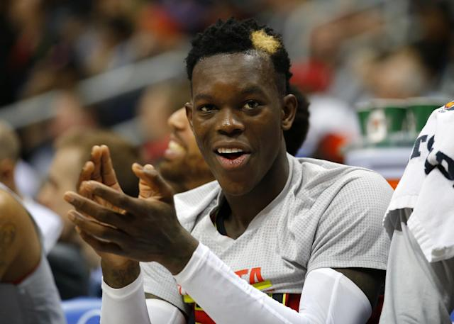 Dennis Schröder claps on the bench. He'll be doing a lot of that on Friday. (AP)