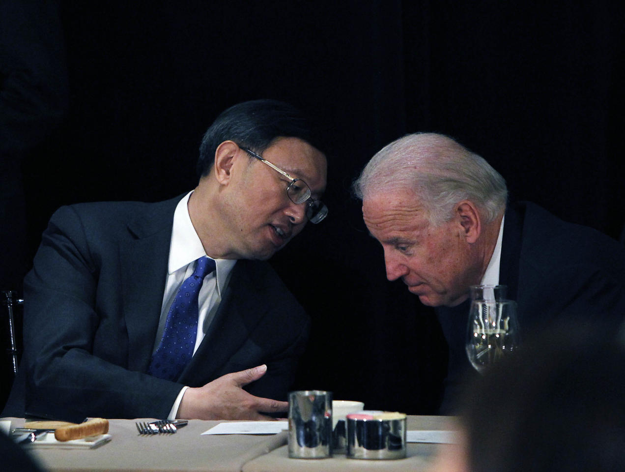 Chinese Foreign Minister Yang Jiechi, left, talks with U.S. Vice President Joe Biden, as China Vice President Xi Jinping, not seen, addresses a luncheon on Friday, Feb. 17, 2012 downtown Los Angeles. Xi is set to lead China for the coming decade, succeeding President Hu Jintao as Communist Party leader late this year, then becoming president in 2013. (AP Photo/Damian Dovarganes)