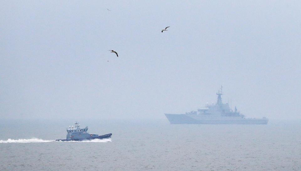 A Border Force patrol vessel and HMS Mersey on patrol in The Channel near Dungeness (PA) (PA Archive)