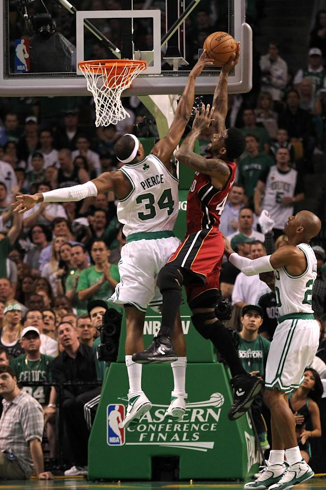 BOSTON, MA - JUNE 07: Udonis Haslem #40 of the Miami Heat attempts a shot in the first quarter against Paul Pierce #34 and Ray Allen #20 of the Boston Celtics in Game Six of the Eastern Conference Finals in the 2012 NBA Playoffs on June 7, 2012 at TD Garden in Boston, Massachusetts. NOTE TO USER: User expressly acknowledges and agrees that, by downloading and or using this photograph, User is consenting to the terms and conditions of the Getty Images License Agreement. (Photo by Jim Rogash/Getty Images)