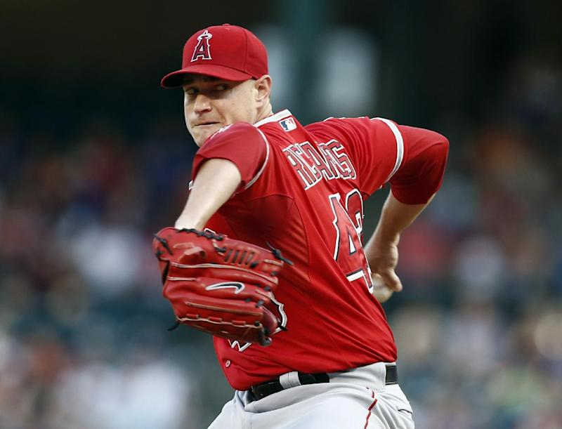 Richards gets 13th win for Angels, 5-4 at Texas