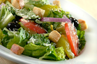 """<p>Consists of romaine lettuce, bacon, croutons and parmesan cheese, served with Caesar dressing. Without the optional grilled season chicken breast, this entrée has 40 grams of fat (10 g saturated) — more fat than a chicken Caesar wrap (33 g) and more sodium (1,490 mg) than a chicken pesto wrap (1,110).<br><br><strong>Salad serving size: 295 g </strong><br> — Calories: 540<br> — Fat: 40 g (Saturated Fat 10 g)<br> — Carbohydrates: 25 g <br> — Sodium: 1,490 mg <br> — Sugar: 2 g <br> — Protein: 18 g<br> — Source/photo: <a href=""""http://d3ixjveba7l33q.cloudfront.net/mobilem8-php/wp-content/uploads/2016/07/PH-Nutritional-complete-April-2016-for-upload-in-July-maintenance-EN.pdf"""" rel=""""nofollow noopener"""" target=""""_blank"""" data-ylk=""""slk:Pizza Hut"""" class=""""link rapid-noclick-resp"""">Pizza Hut</a><br><br><strong>TRY THIS INSTEAD:</strong> Pizza Hut Italian house salad entrée (Fat: 4 g/Sat. Fat 1 g/Sodium: 390 mg) </p>"""