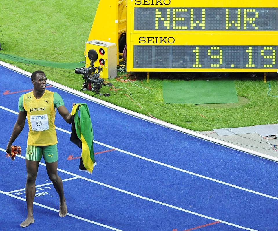 Jamaica's Usain Bolt sets a new World Record to win the Men's 200m Final during the IAAF World Championships at the Olympiastadion, Berlin.