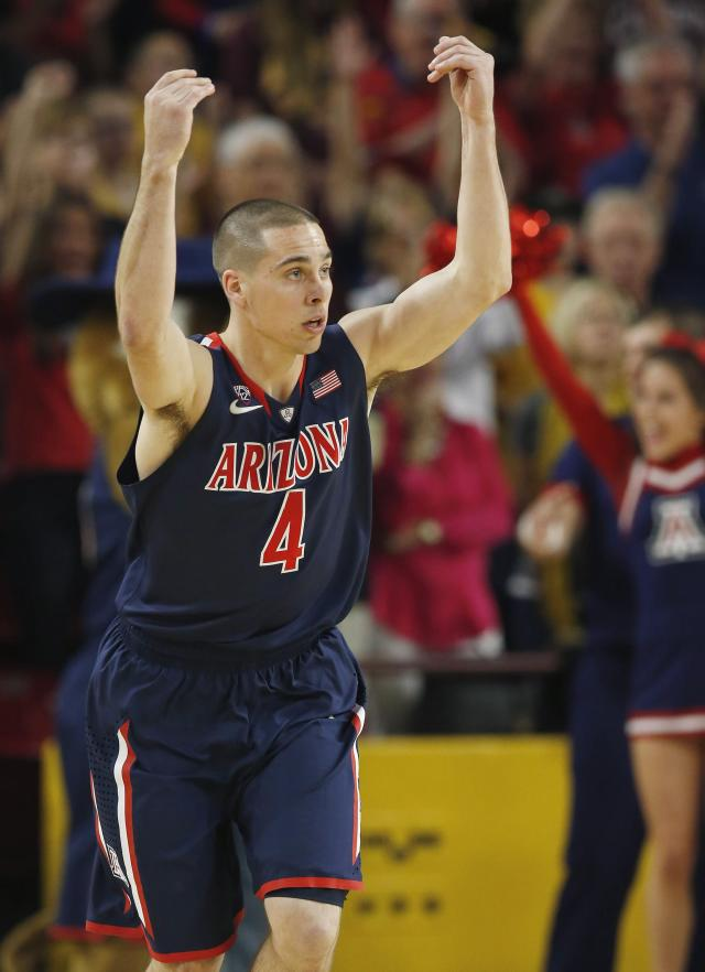Arizona's T.J. McConnell celebrates a 3-point basket against Arizona State during the first half of an NCAA college basketball game on Friday, Feb. 14, 2014, in Tempe, Ariz. (AP Photo/Ross D. Franklin)