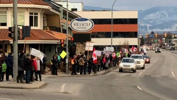 About 1,000 people attended a rally in Kelowna, B.C., on Dec. 12, 2020 against provincial health restrictions intended to curb the spread of COVID-19.