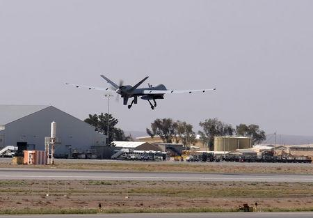 A U.S. Air Force MQ-9 Reaper drone takes off from Kandahar Airfield, Afghanistan