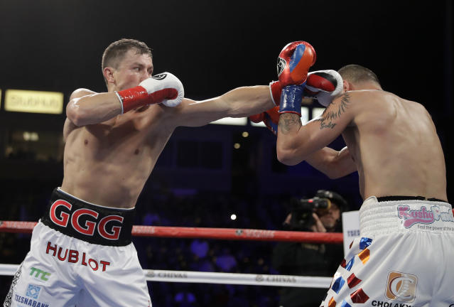 Gennady Golovkin, left, hits Vanes Martirosyan during their middleweight title boxing match, Saturday, May 5, 2018, in Carson, Calif. Golovkin won the bout. (AP Photo/Chris Carlson)