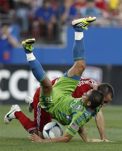 Seattle Sounders forward David Estrada is upended competing for the ball against FC Dallas' Andrew Jacobson in the first half of an MLS soccer game, Wednesday, May 9, 2012, in Frisco, Texas. (AP Photo/Tony Gutierrez)