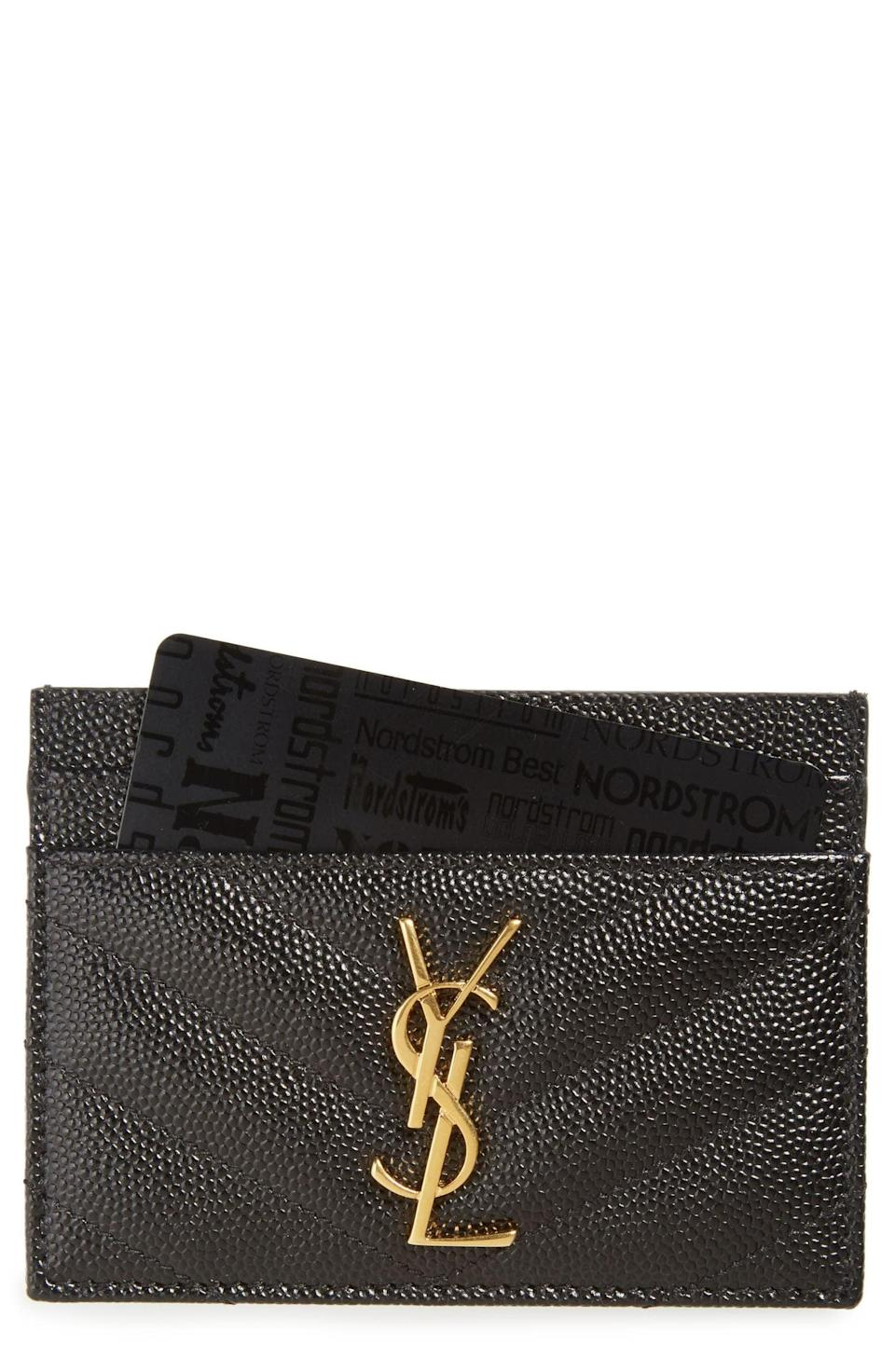 <p>Go above and beyond by surprising them with this luxe <span>Saint Laurent Monogram Quilted Leather Credit Card Case</span> ($275). It's so useful, and great to throw into even the tiniest bags.</p>