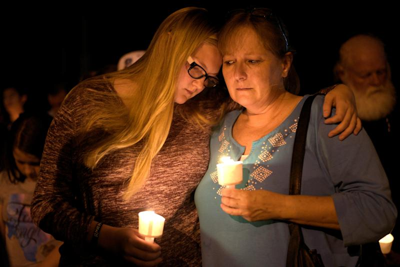 Terri and Brooke Kalinec attend a candlelight vigil after a mass shooting at the First Baptist Church in Sutherland Springs, Texas, on Nov. 5, 2017. (Reuters/Sergio Flores)