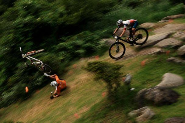 PHOTO: Mathieu van der Poel of the Netherlands tumbles on a downhill during the men's cross country mountain bike competition at the 2020 Summer Olympics, Monday, July 26, 2021, in Izu, Japan. (Thibault Camus/AP Photo)