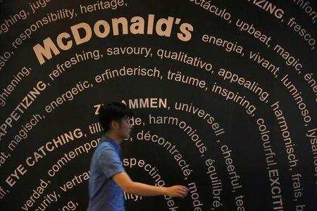 A passerby walks past a McDonald's store in Tokyo July 31, 2014.  REUTERS/Issei Kato